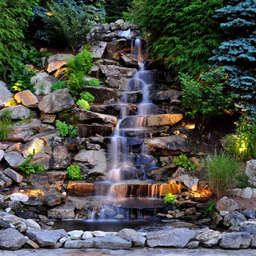 Waterfall feature in mountain landscape design
