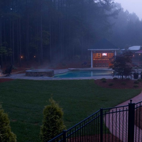 Residential landscape design Charlotte NC - patio, outdoor kitchen, swimming pool, hot tub, outdoor fireplace